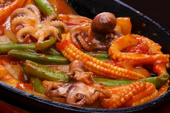 Seafood fajitas. Fajitas with baby octopuses on a frying pan. Latin cuisine Royalty Free Stock Photography