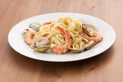 Seafood Fettuccini Alfredo. On a desk Stock Photography