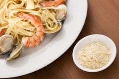 Seafood Fettuccini Alfredo. On a desk Stock Photo