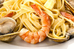 Seafood Fettuccini Alfredo. On a desk Stock Photos