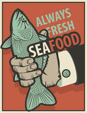 Seafood with fish in hand. Retro banner for seafood with fish in hand Stock Photography