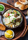 Seafood fish soup in clay bowls served with lemon and coriander. Top view, copy space Royalty Free Stock Photos