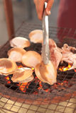 Seafood on the flaming grill Royalty Free Stock Image