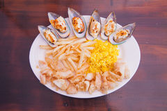 Seafood with French fries and rice Royalty Free Stock Photo