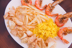 Seafood with French fries and rice Stock Photo