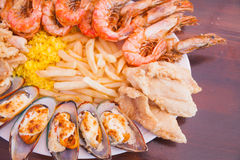 Seafood with French fries and rice Stock Photography