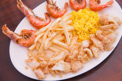 Seafood with French fries and rice Royalty Free Stock Image