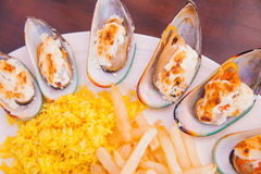 Seafood with French fries and rice Royalty Free Stock Images