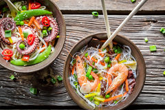 Seafood and fresh vegetables with noodles Stock Photos