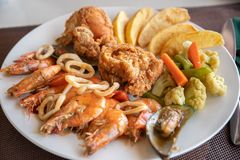 Seafood, Fried chicken with french fries royalty free stock images