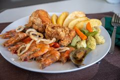 Seafood, Fried chicken with french fries royalty free stock image