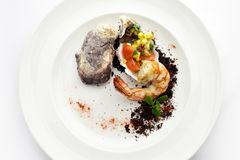 Seafood. Fried grilled shrimp prawns with molluscs. On white plate Royalty Free Stock Photo