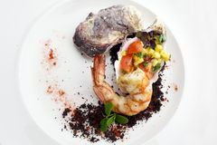 Seafood. Fried grilled shrimp prawns with molluscs. On white plate Stock Photo