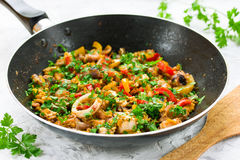 Seafood fried on pan with pepper egg and parsley Royalty Free Stock Image