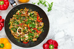 Seafood fried on pan with pepper egg and parsley Stock Photo
