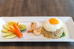 Seafood fried rice. With squid and shrimp top with fried egg Royalty Free Stock Photo