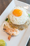 Seafood fried rice. With squid and shrimp top with fried egg Stock Photos