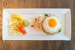 Seafood fried rice. With squid and shrimp top with fried egg Royalty Free Stock Image