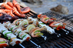 Seafood on grill stock images