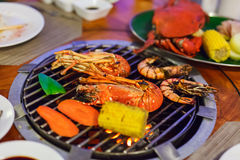 Seafood at grill Stock Images