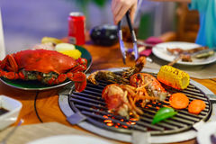 Seafood at grill Stock Photos