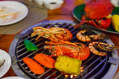 Seafood at grill Royalty Free Stock Images