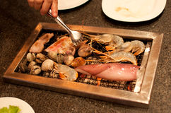 Seafood on the grill Royalty Free Stock Images