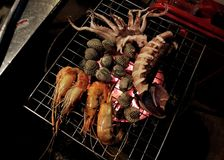 Seafood grill Stock Images