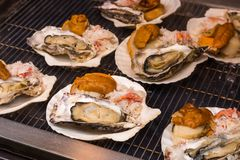 Seafood grill - street food in Tsukiji fish market, Tokyo, Japan.  stock photo