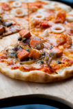 Seafood half Salmon Pizza Stock Image