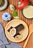 Seafood hand roll sushi. On wooden plate royalty free stock photo