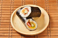 Seafood hand roll sushi. On wooden plate stock photos