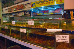 Seafood on ice at the fish market. Variety of grilled seafood in Kota Kinabalu market. Malaysia Stock Photo