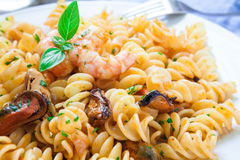 Seafood italian pasta style. Homemade italian pasta with seafood and basil Stock Image