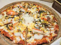 Seafood Italian Pizza slice on wood dish Stock Photo