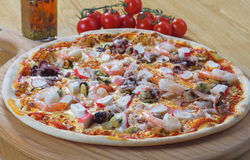 Seafood Italian Pizza on wood dish Royalty Free Stock Images