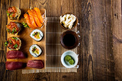 Seafood, Japanese sushi on the old wooden table Stock Images