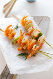 Seafood kebabs with pink prawns Stock Photo