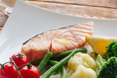 Seafood in lent. Salmon steak and vegetables. Stock Photography