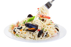 Seafood Linguine. Plate of pasta with shrimp, mussels and mixed seafood. Shot on a white background Royalty Free Stock Photo