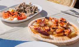 Seafood lunch with pulpo. Sardines and potatoes. Mallorca, Balearic islands, Spain Stock Image