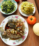 Seafood luncheon. Family seafood luncheon - catfish in soy sauce, vegetables and fruits grapes Stock Photography