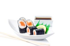 Seafood Maki sushi in white plate isolated on white background Stock Images