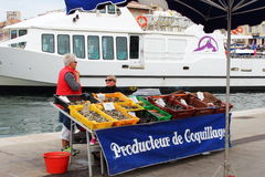 Seafood market in the port of Marseille, France. Shells selling in the French town Marseilles, known to the ancient Greeks and Romans as Massalia. Marseille, now Stock Photography