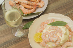 Seafood with mayonnaise. Peeled prawns with mayonnaise, glass of white wine Royalty Free Stock Image