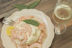 Seafood with mayonnaise. Peeled prawns with mayonnaise, glass of white wine Stock Photos