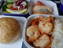 Seafood meal for lunch on airplane cabin stock images