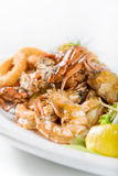 Seafood meal with shrimp. Seafood main dish served with shrimps, crabs and calamari Stock Photography