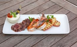 Seafood and meat in one plate Royalty Free Stock Photos