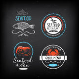 Seafood menu and badges design elements. Royalty Free Stock Images